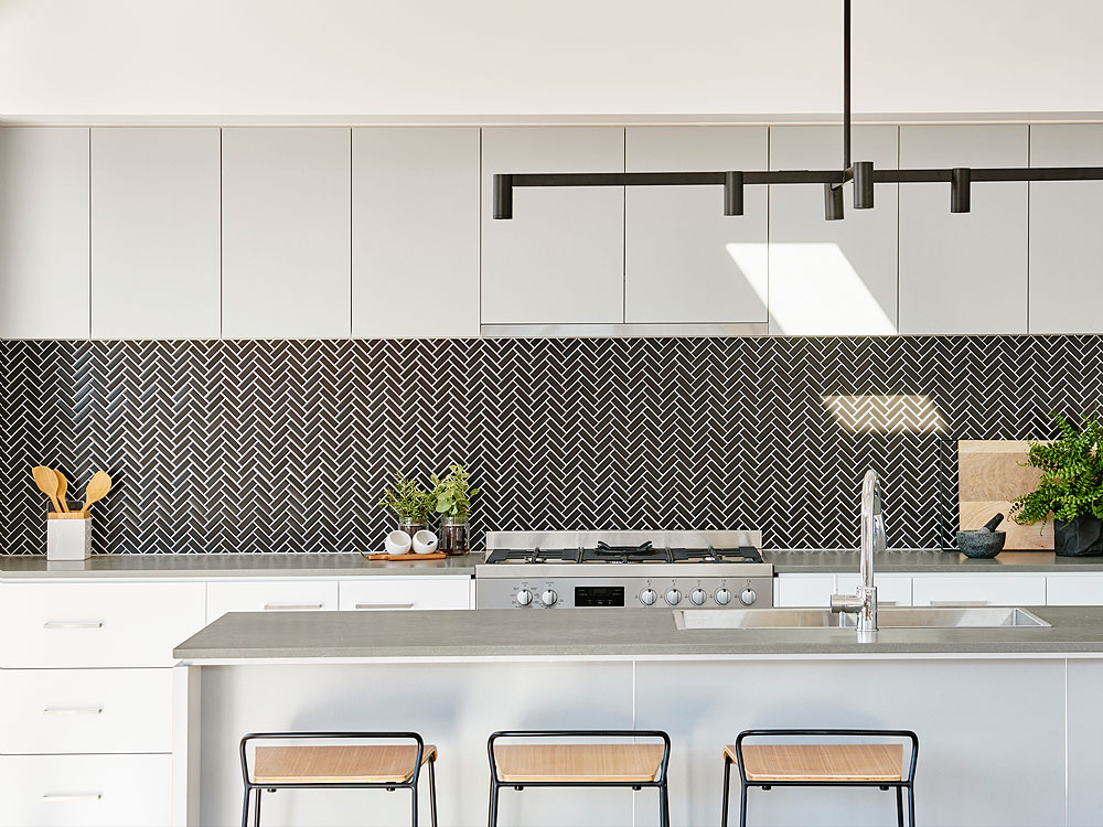 Pendant lighting can solidify the style of your kitchen like this industry style pendant in our Arcadia 206 in Oakdene Estate.