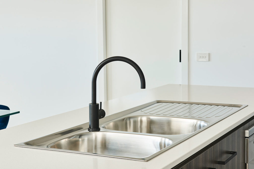 Add interest to your kitchen by upgrading your tapware. Matte black tapware is on display in our Thornhill 212 in Anchoridge Estate.